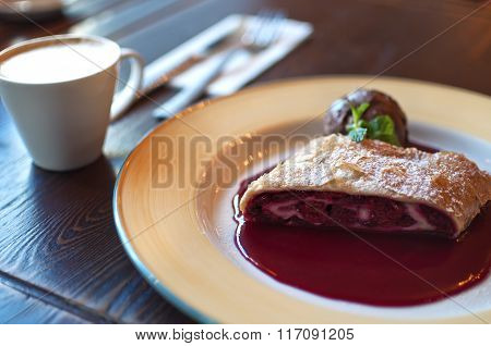 Plate Of Cherry Strudel And Cup Of Coffee