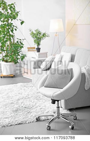 Living room design with armchair and sofa