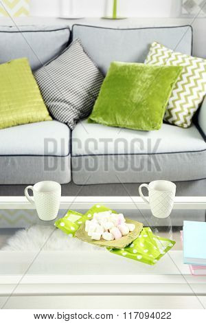 Low table with marshmallows and two cups in living room