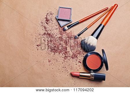 Set of decorative cosmetics on color background
