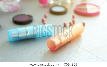 Perfume bottles with makeup cosmetics and tools on a table