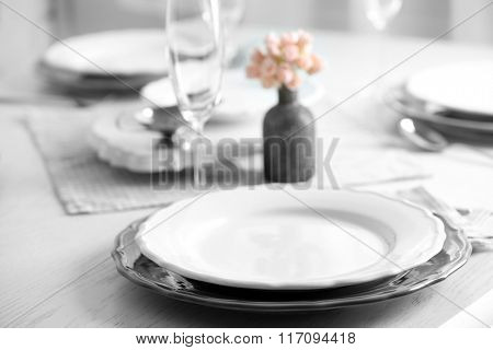 Table set at restaurant on light background