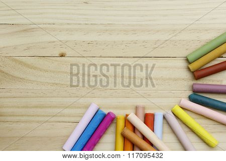 colorful chalks on  wooden table.