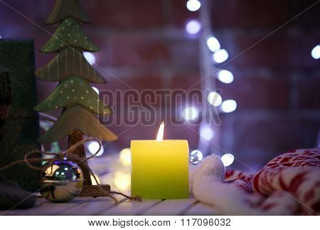 Christmas decoration and candle on the wooden table