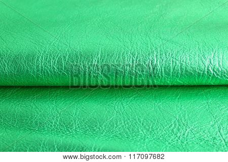 Green leather texture close up