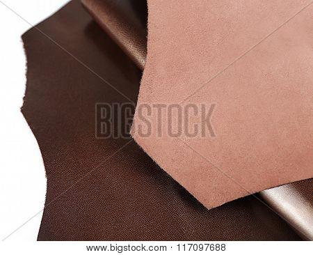 Dark brown leather on white background, close up