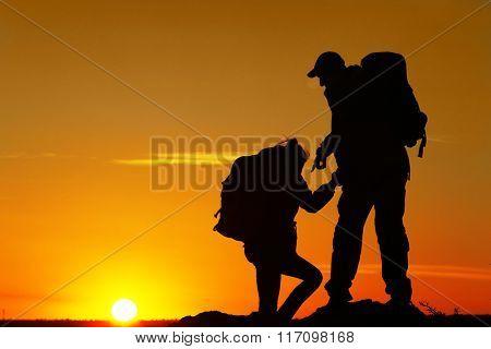 Man and woman climbing the mountain