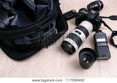 Photographer's equipment on the floor in a room