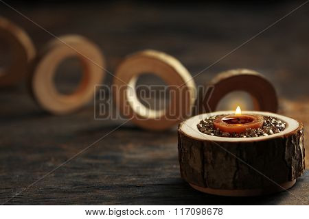 Burning wooden candle with sea salt, closeup