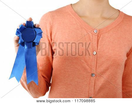 Woman with award ribbon, close-up, isolated on white