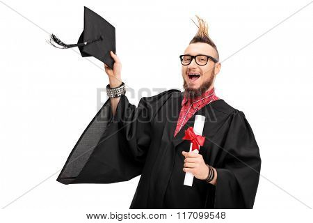 Young man with a Mohawk hairstyle celebrating his graduation isolated on white background