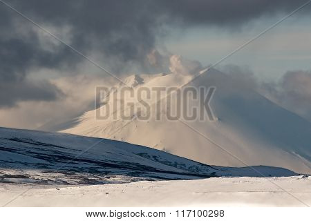 mountains covered with snow in a Blizzard on the Kuril Islands