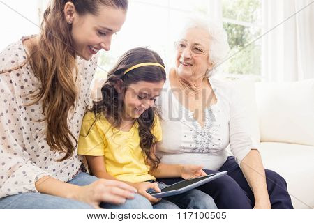 Focused senior man using tablet at home