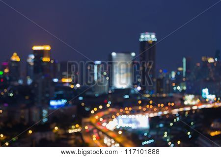 Abstract blurred bokeh city downtown lights background