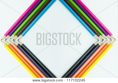 Frame Form Multicolored Pencils Isolated On White Background.