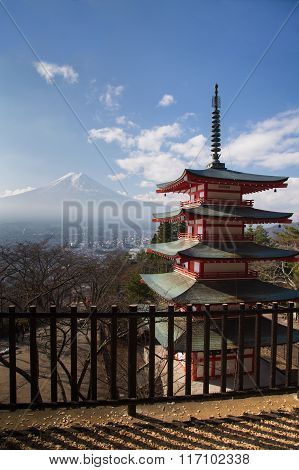 Mt. Fuji viewed from behind red Chureito Pagoda
