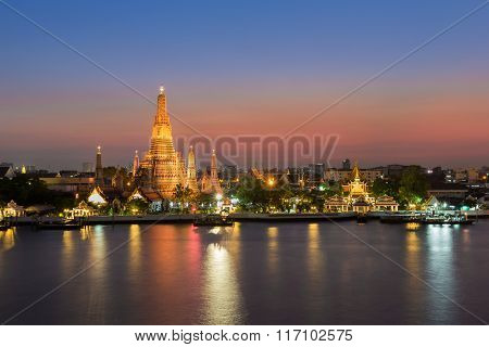 Wat Arun - the Temple of Dawn water front at twilight