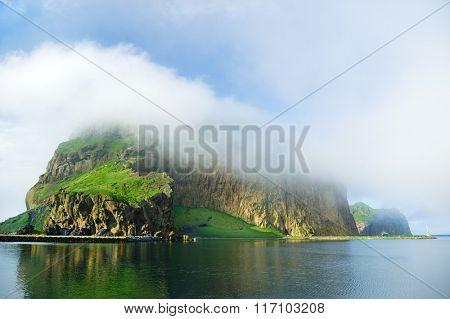 Fog covered green island