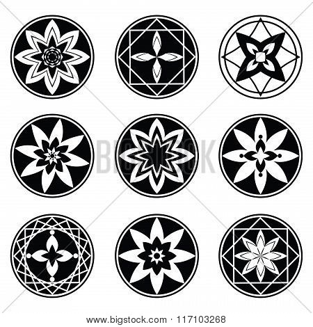 Floral, mandala tattoo set. Four and eight rays aster, star, flower signs. Black ornaments on white