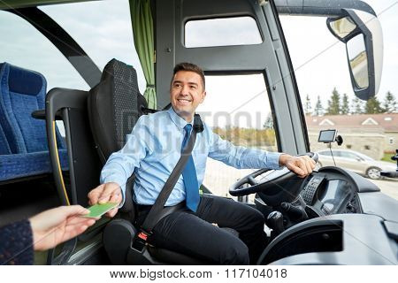 bus driver taking ticket or card from passenger