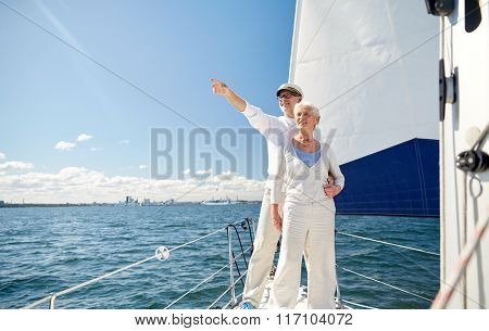 senior couple sailing on boat or yacht in sea