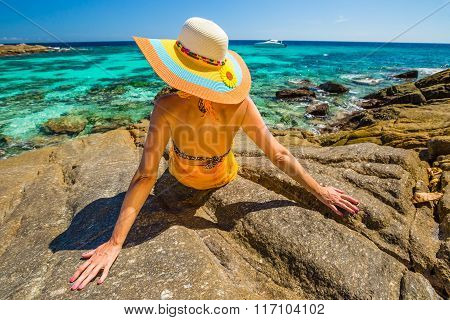 Woman looking tropical sea