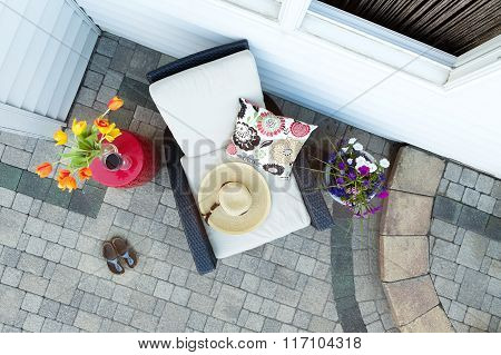 Relaxing Luxury Patio With Chair And Glass Of Wine