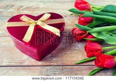 close up of red tulips and chocolate box
