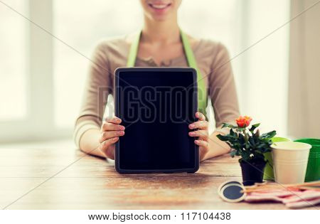 close up of woman or gardener with tablet pc