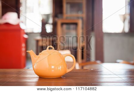 Tea Pot On Wooden Table