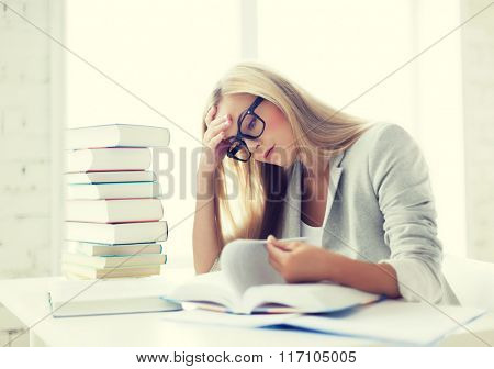 student with books and notes