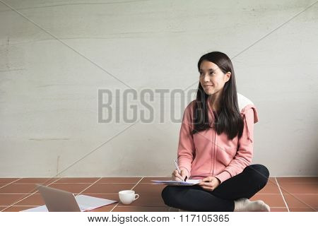 Asian woman working at home.