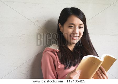 Asian beautiful woman read a book at home.