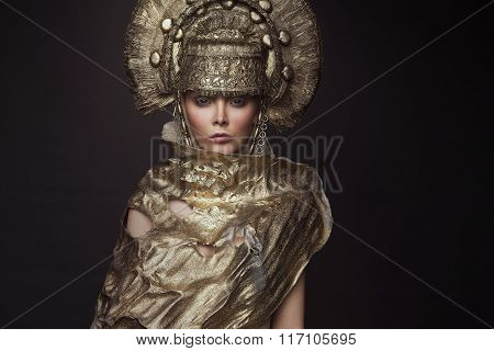 Woman in gold kokoshnik head wear
