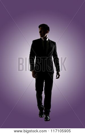 Confident businessman walking, silhouette portrait isolated
