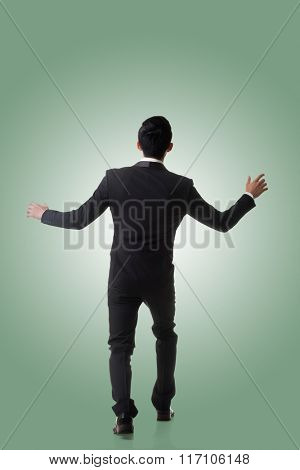 Asian business man surprised with outrageously and funny pose, full length portrait isolated