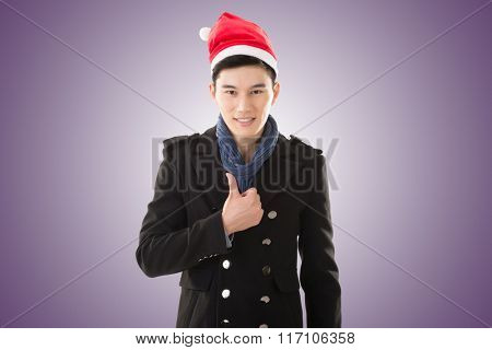 Attractive Asian young man with christmas hat, closeup portrait.