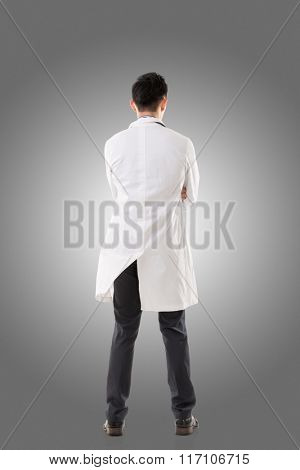 Rear view of Asian medical doctor, full length portrait isolated