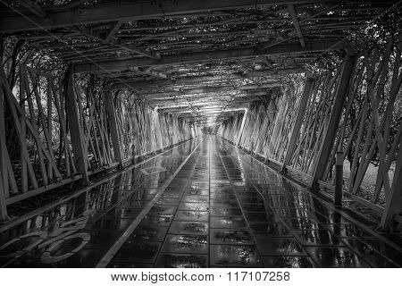 Pedestrian And Cycling Tunnel After Rainfall In Black And White
