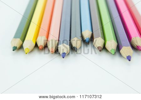 Idea from multicolored pencils isolated on white background.