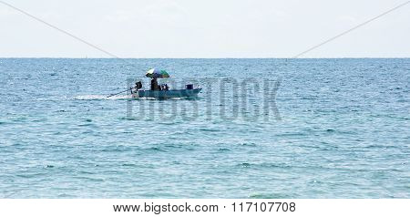 Silhouetted Fishing Boat With Bright Highlights And Reflections In Waves Asia