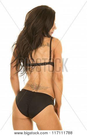 Woman In Black Bikini From Back Look To Side