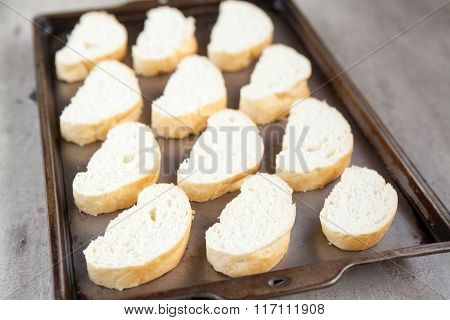 Cut French Loaf Bread On Baking Tray