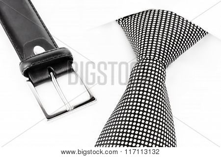 black and white spotted tie and leather belt