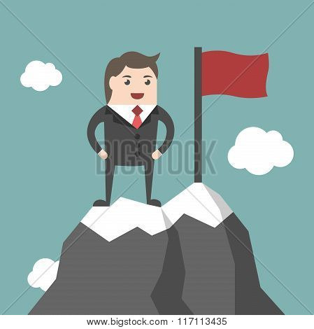 Businessman On Mountain Summit
