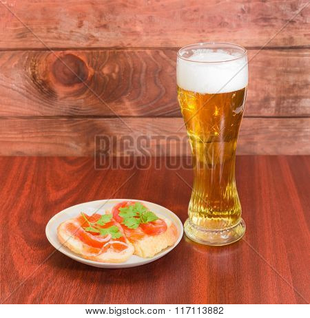 Beer Glass With Lager Beer And Sandwiches With Salted Trout
