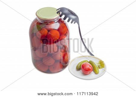 Canned Tomato And Cucumbers On Saucer And In Glass Jar