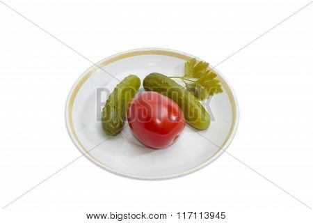 Pickled Cucumbers And Tomato On A Saucer