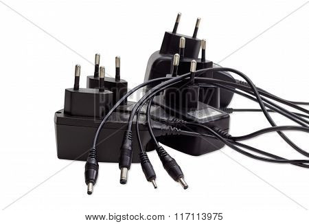 Battery Chargers For Various Gadgets On A Light Background