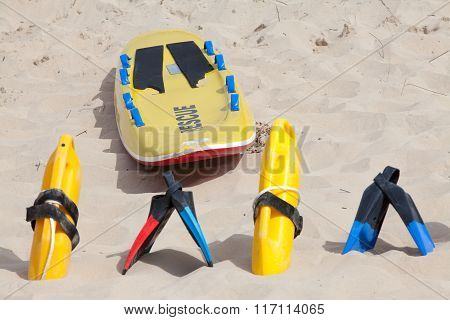 Lifesaving Equipment Lying On The Beach Sand